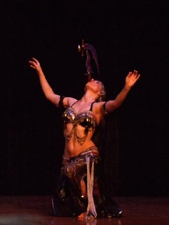 Melina performs a breath taking belly dance while balancing a sword on the tip of a dagger 143