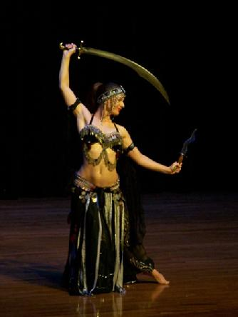 Melina performs a breath taking belly dance while balancing a sword on the tip of a dagger 187