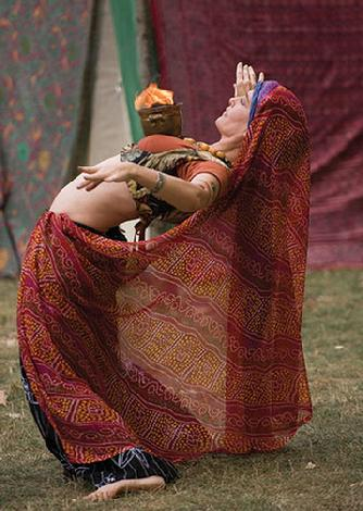 Rebecca in Tribal finery dancing with fire